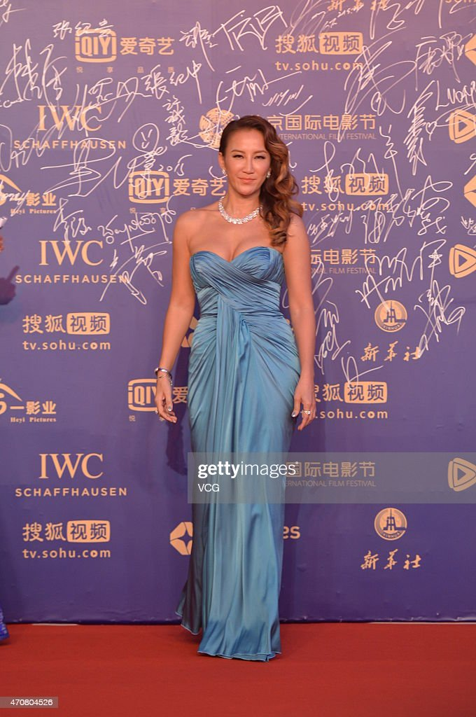 Singer <a gi-track='captionPersonalityLinkClicked' href=/galleries/search?phrase=CoCo+Lee&family=editorial&specificpeople=2081343 ng-click='$event.stopPropagation()'>CoCo Lee</a> walks the red carpet during the closing ceremony of the 5th Beijing International Film Festival at Beijing Yanqi Lake International Convention & Exhibition Center on April 23, 2015 in Beijing, China.