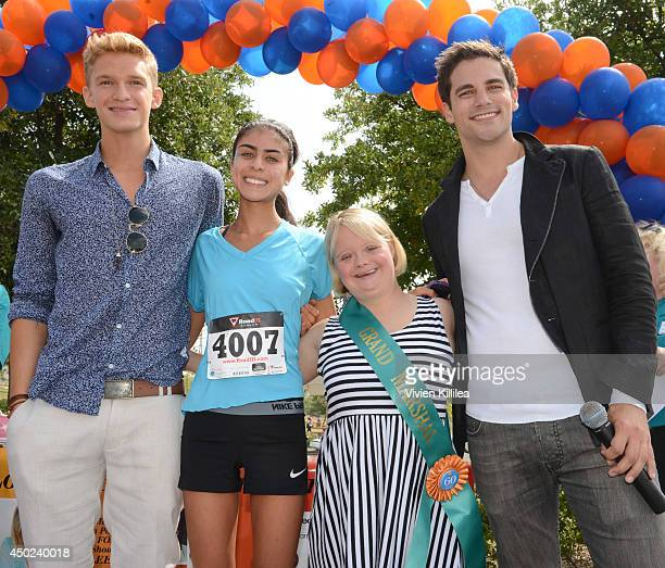 Singer Cody Simpson actress Lauren Potter and actor Brant Daugherty present the award to the runner up in the women's category at the New Horizons 5K...