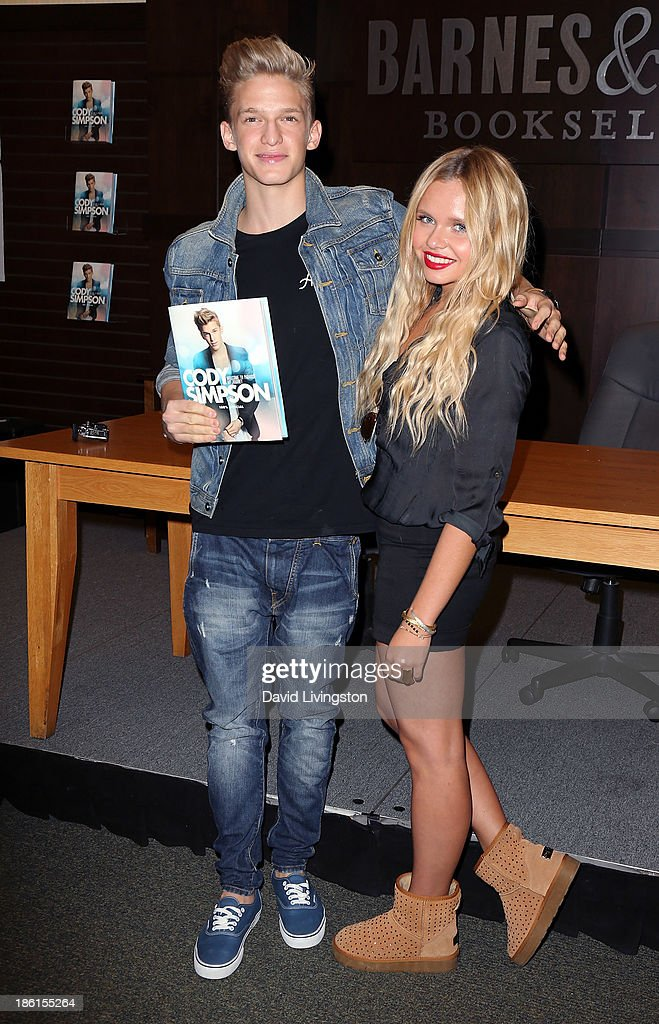 Singer <a gi-track='captionPersonalityLinkClicked' href=/galleries/search?phrase=Cody+Simpson&family=editorial&specificpeople=7068455 ng-click='$event.stopPropagation()'>Cody Simpson</a> (L) and sister TV personality <a gi-track='captionPersonalityLinkClicked' href=/galleries/search?phrase=Alli+Simpson&family=editorial&specificpeople=7439624 ng-click='$event.stopPropagation()'>Alli Simpson</a> attend a signing for <a gi-track='captionPersonalityLinkClicked' href=/galleries/search?phrase=Cody+Simpson&family=editorial&specificpeople=7068455 ng-click='$event.stopPropagation()'>Cody Simpson</a>'s book 'Welcome to Paradise' at Barnes & Noble bookstore at The Grove on October 28, 2013 in Los Angeles, California.
