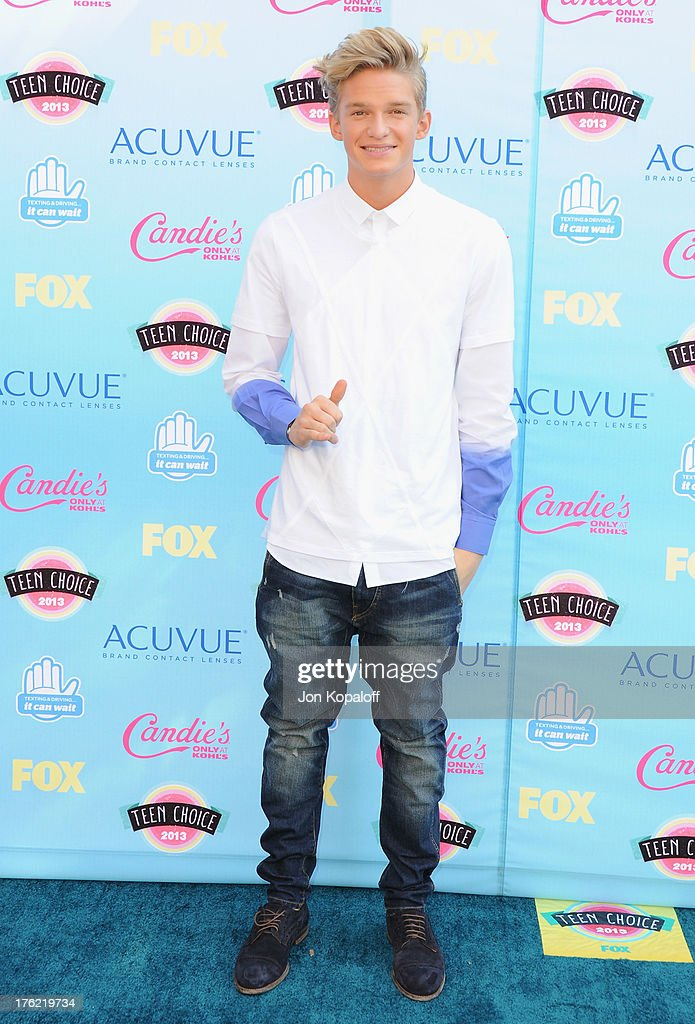 Singer <a gi-track='captionPersonalityLinkClicked' href=/galleries/search?phrase=Cody+Simpson&family=editorial&specificpeople=7068455 ng-click='$event.stopPropagation()'>Cody Simpson</a> arrives at the 2013 Teen Choice Awards at Gibson Amphitheatre on August 11, 2013 in Universal City, California.
