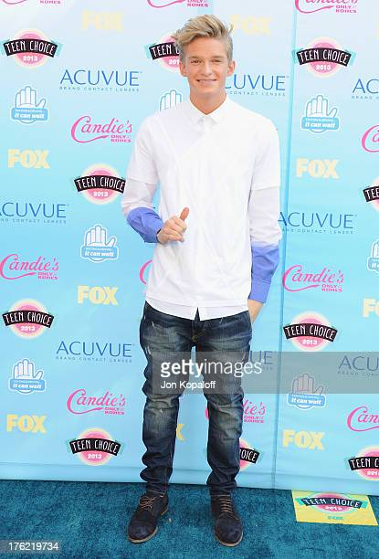 Singer Cody Simpson arrives at the 2013 Teen Choice Awards at Gibson Amphitheatre on August 11 2013 in Universal City California