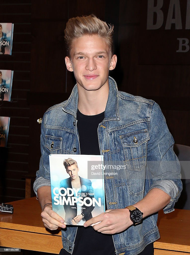 Singer <a gi-track='captionPersonalityLinkClicked' href=/galleries/search?phrase=Cody+Simpson&family=editorial&specificpeople=7068455 ng-click='$event.stopPropagation()'>Cody Simpson</a> attends a signing for his book 'Welcome to Paradise' at Barnes & Noble bookstore at The Grove on October 28, 2013 in Los Angeles, California.