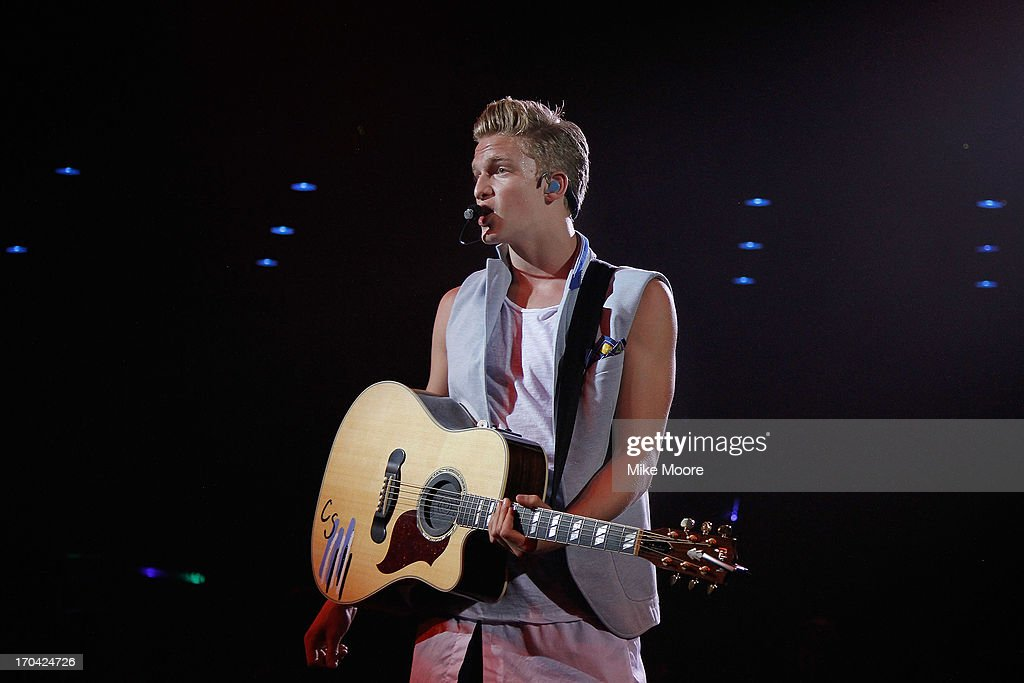 Singer <a gi-track='captionPersonalityLinkClicked' href=/galleries/search?phrase=Cody+Simpson&family=editorial&specificpeople=7068455 ng-click='$event.stopPropagation()'>Cody Simpson</a> performs at the Celebrity Theatre on June 12, 2013 in Phoenix, Arizona.