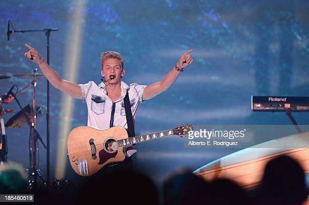 Singer Cody Simpson performs at the Hub Network's 1st Annual Halloween Bash at Barker Hangar on October 20 2013 in Santa Monica California