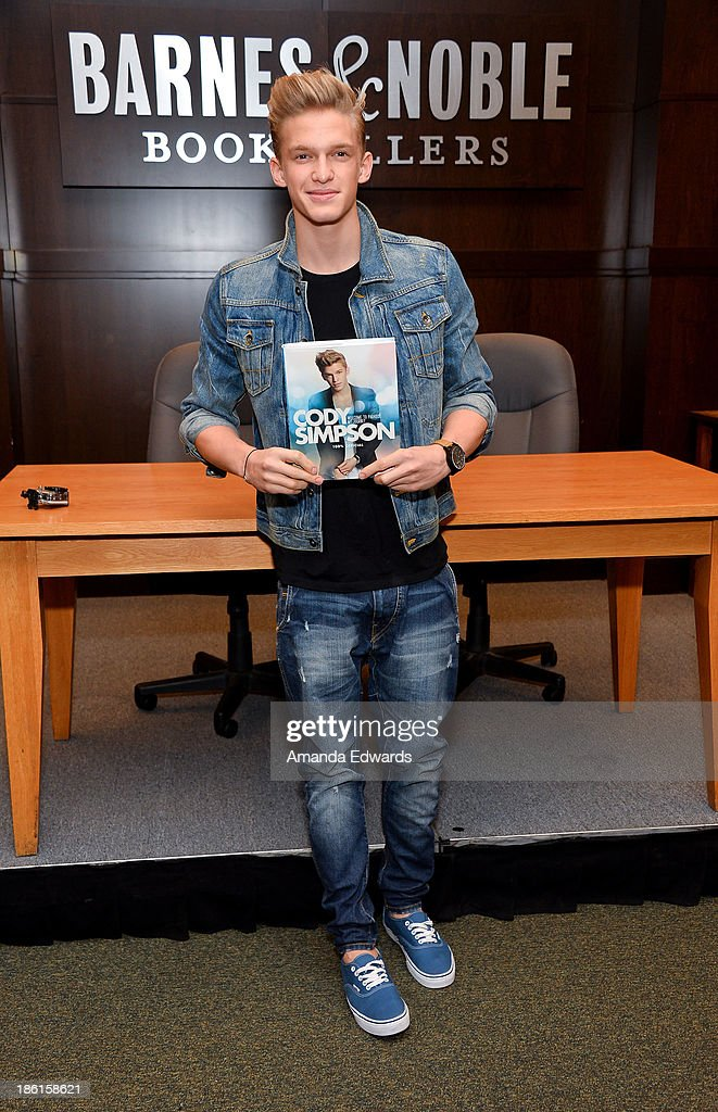 Singer <a gi-track='captionPersonalityLinkClicked' href=/galleries/search?phrase=Cody+Simpson&family=editorial&specificpeople=7068455 ng-click='$event.stopPropagation()'>Cody Simpson</a> poses before signing copies of his new book 'Welcome To Paradise' at Barnes & Noble bookstore at The Grove on October 28, 2013 in Los Angeles, California.
