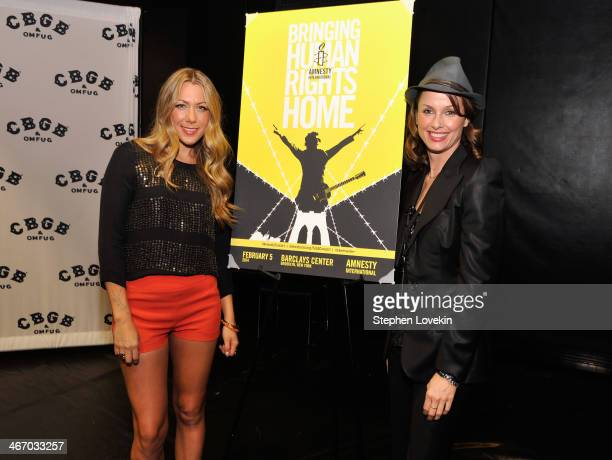 Singer Colbie Caillat and actress Bridget Moynahan attend the Amnesty International Concert presented by the CBGB Festival at Barclays Center on...
