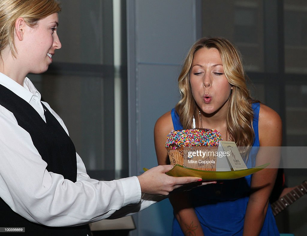 Singer Colbie Caillat blows out a birthday cake at the VH1 Save The Music Foundation Summer Kick-Off Party benefit at the W Hoboken on May 23, 2010 in Hoboken, New Jersey.