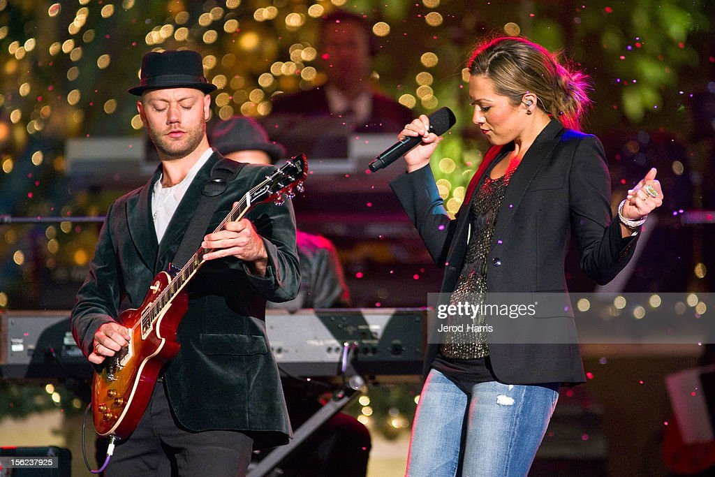 Singer Colbie Caillat (R) performs at A Hollywood Christmas Celebration at The Grove on November 11, 2012 in Los Angeles, California.