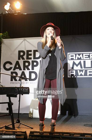 Singer Colbie Caillat performs at the 2014 American Music Awards Radio Row at Nokia Theatre LA Live on November 21 2014 in Los Angeles California