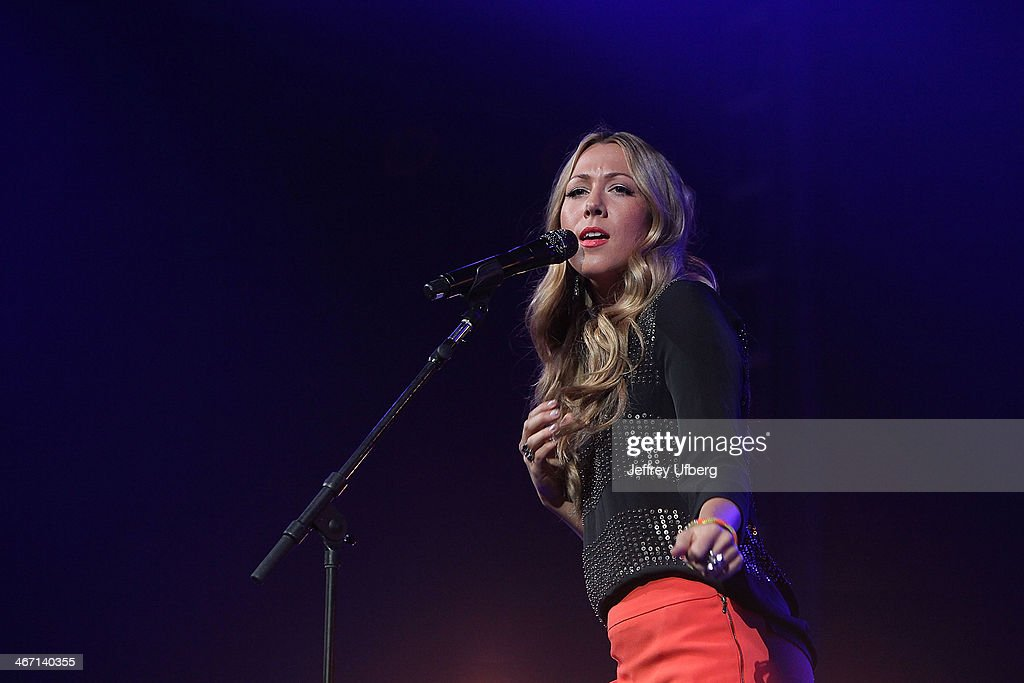 Singer Colbie Caillat performs during the Amnesty International 'Bringing Human Rights Home' Concert at the Barclays Center on February 5, 2014 in the Brooklyn borough of New York City.