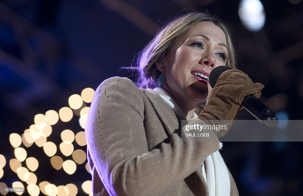 Singer Colbie Caillat performs during the National Christmas Tree Lighting on the Ellipse adjacent to the White House in Washington, DC, on December 6, 2012. The annual event, hosted by Actor Neil Patrick Harris, features US President Barack Obama and performances by Jason Mraz, Ledisi, James Taylor, Kenny 'Babyface' Edmonds, Colbie Caillat and American Idol season 11 winner Phillip Phillips. AFP PHOTO / Saul LOEB