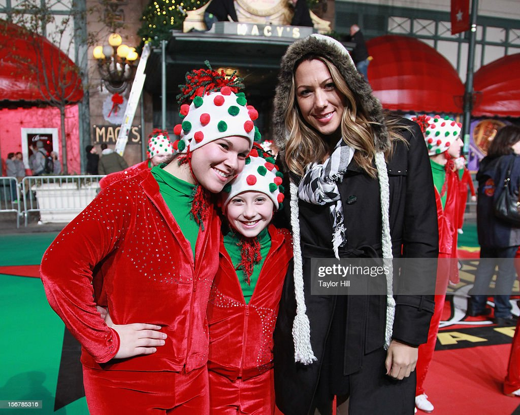 Singer Colbie Caillat poses with members of the Heartland Hoedowners of Elkhorn, Nebraska during day two of the 86th Anniversary Macy's Thanksgiving Day Parade Rehearsals at Macy's Herald Square on November 20, 2012 in New York City.