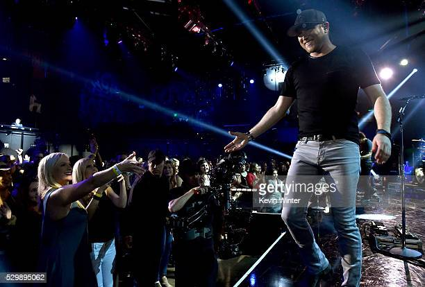 Singer Cole Swindell performs live on the ATT Stage at iHeartRadio Theater on May 3 2016 in Burbank California