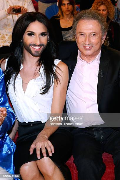 Singer Conchita Wurst and presenter of the show Michel Drucker attend the 'Vivement Dimanche' French TV Show Held at Pavillon Gabriel on October 29...
