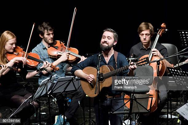 Singer Conor J OBrien of the Irish band Villagers performs live with Stargaze orchestra during a concert at the Volksbuehne on December 13 2015 in...
