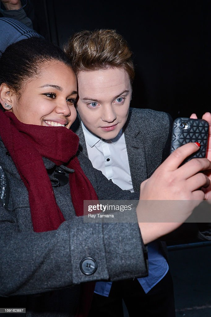 Singer Conor Maynard poses with a fan as he leaves the 'Good Morning America' taping at ABC Times Square Studios on January 8, 2013 in New York City.