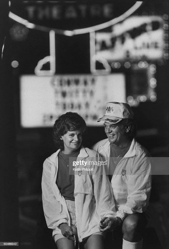 C/W singer Conway Twitty w. wife Dee standing on Highway 76 strip.