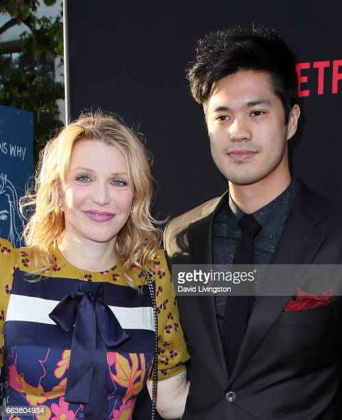 Singer Courtney Love and actor Ross Butler attend the premiere of Netflix's '13 Reasons Why' at Paramount Pictures on March 30 2017 in Los Angeles...