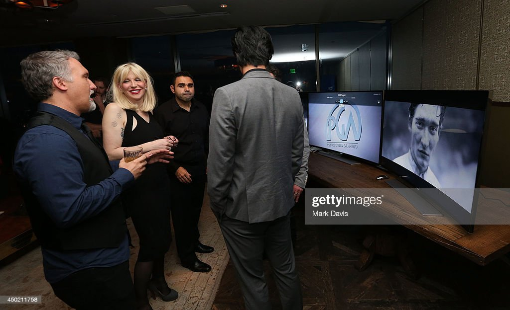 Singer Courtney Love (2nd-L) attends the 'Producers Guild Digital VIP Event' held at Soho House on June 6, 2014 in West Hollywood, California.