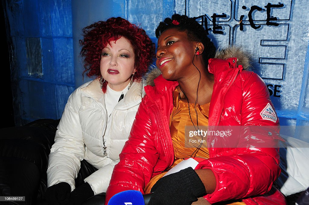 Singer Cyndi Lauper and TV hostess Aline Afanoukoe attend the Cyndi Lauper DJ Set at the Kube Hotel on October 7 2010 in Paris France