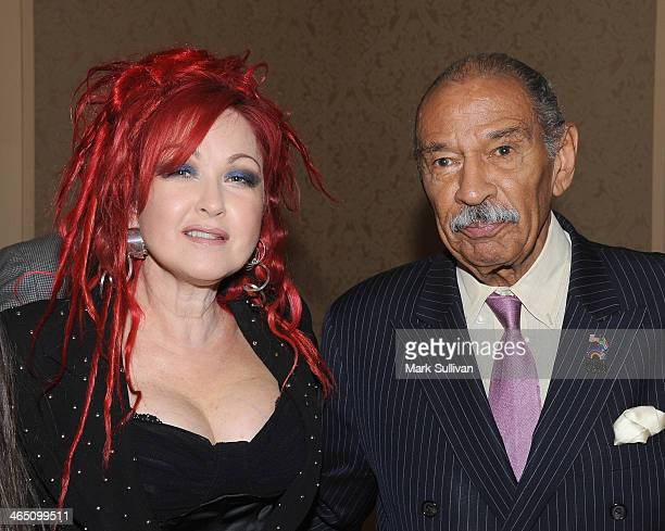 Singer Cyndi Lauper and US Representative John Conyers attend the 56th GRAMMY Awards Congressional Briefing at the Beverly Hilton Hotel on January 25...