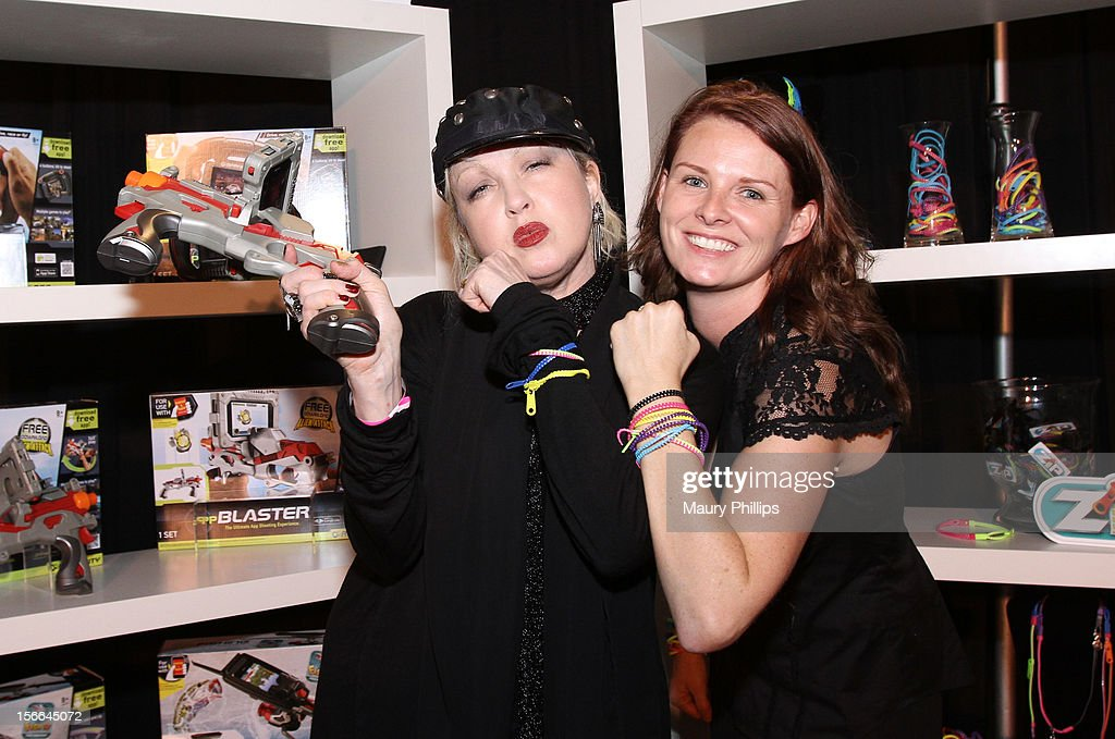 Singer <a gi-track='captionPersonalityLinkClicked' href=/galleries/search?phrase=Cyndi+Lauper&family=editorial&specificpeople=171290 ng-click='$event.stopPropagation()'>Cyndi Lauper</a> visits Rachel Griffin at the American Music Awards Artists Gift Lounge - Day 2 at LA Live on November 17, 2012 in Los Angeles, California.