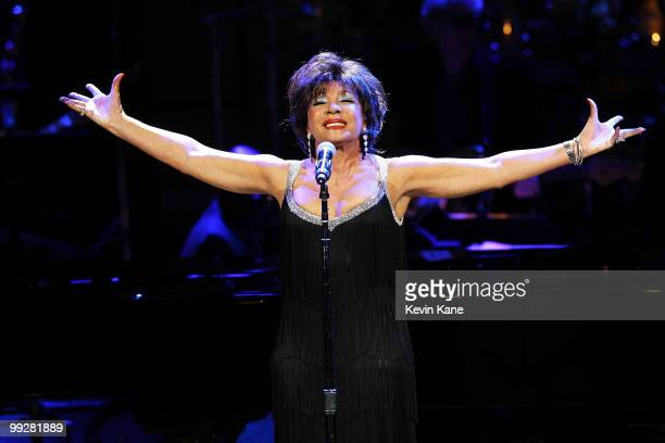 Singer Dame Shirley Bassey performs on stage during the Almay concert to celebrate the Rainforest Fund's 21st birthday at Carnegie Hall on May 13...