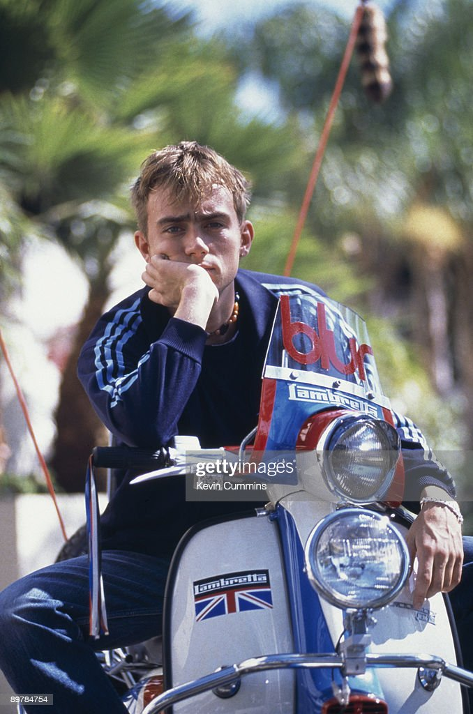 Singer Damon Albarn of English pop group Blur on a Lambretta scooter with the band's name on the windscreen Los Angeles California September 1994