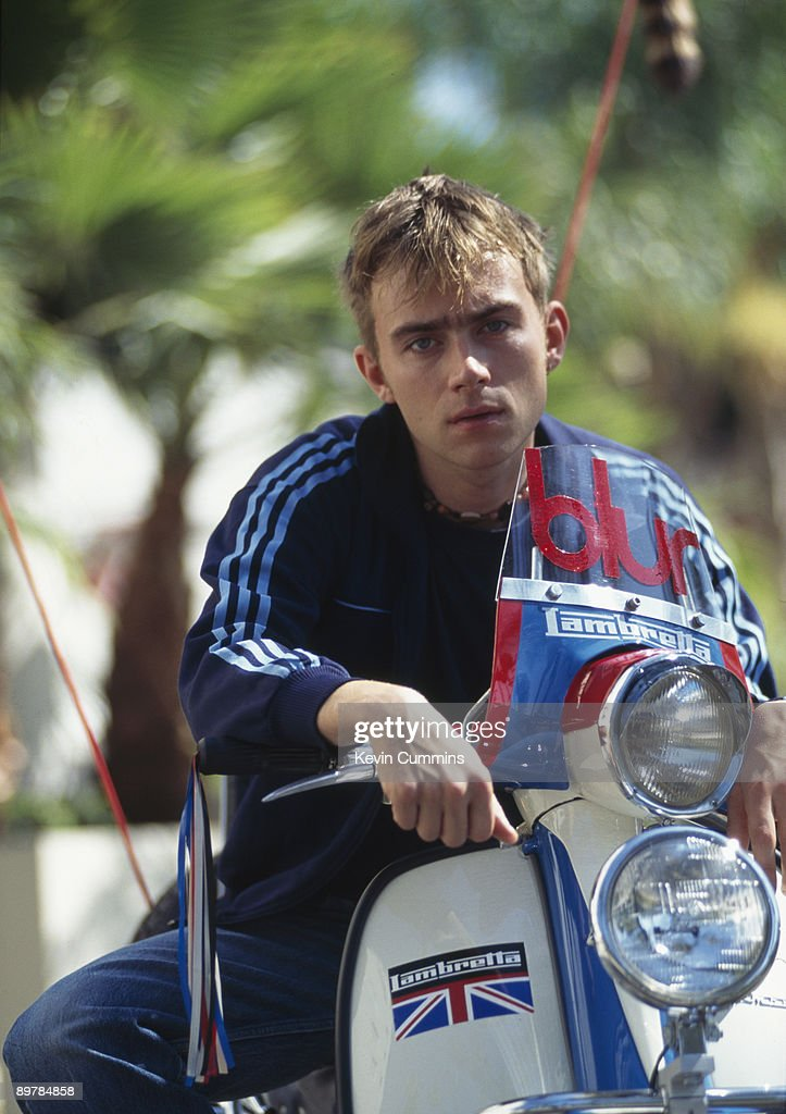 Singer Damon Albarn of English pop group Blur on a Lambretta scooter with the band's name on the windscreen, Los Angeles, California, September 1994.