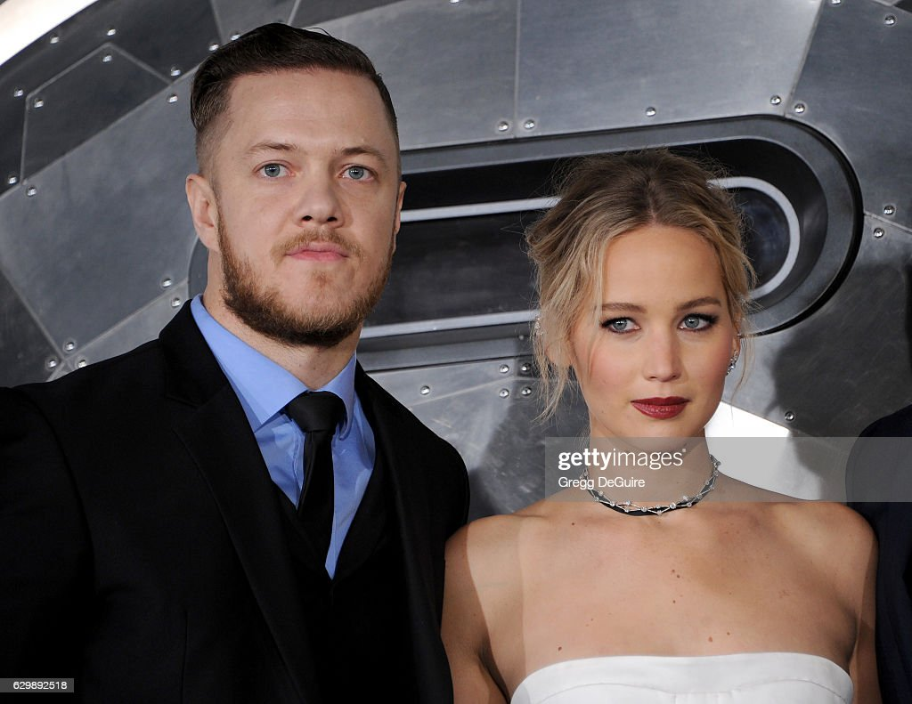 Singer Dan Reynolds of Imagine Dragons and actress Jennifer Lawrence arrive at the premiere of Columbia Pictures' 'Passengers' at Regency Village Theatre on December 14, 2016 in Westwood, California.