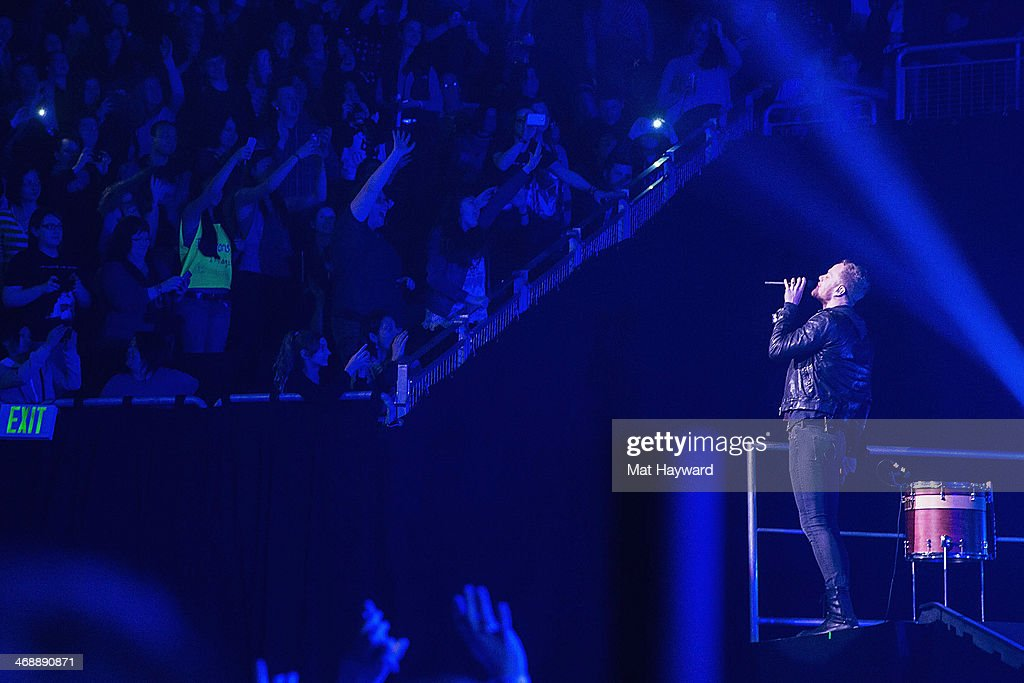 Singer <a gi-track='captionPersonalityLinkClicked' href=/galleries/search?phrase=Dan+Reynolds&family=editorial&specificpeople=8995077 ng-click='$event.stopPropagation()'>Dan Reynolds</a> of Imagine Dragons performs on stage at KeyArena on February 11, 2014 in Seattle, Washington.