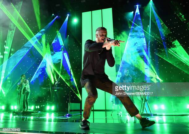 Singer Dan Reynolds of Imagine Dragons performs onstage during the 2017 Billboard Music Awards at TMobile Arena on May 21 2017 in Las Vegas Nevada