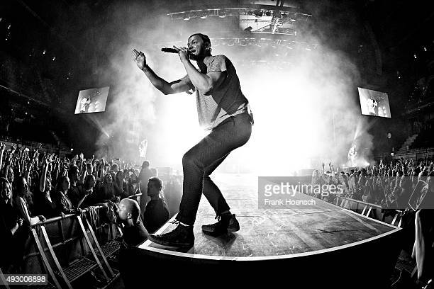 Singer Dan Reynolds of the American band Imagine Dragons performs live during a concert at the MaxSchmelingHalle on October 16 2015 in Berlin Germany