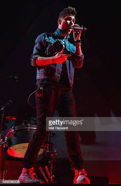 Singer Dan Smith of Bastille performs on stage at KeyArena on November 25 2014 in Seattle Washington