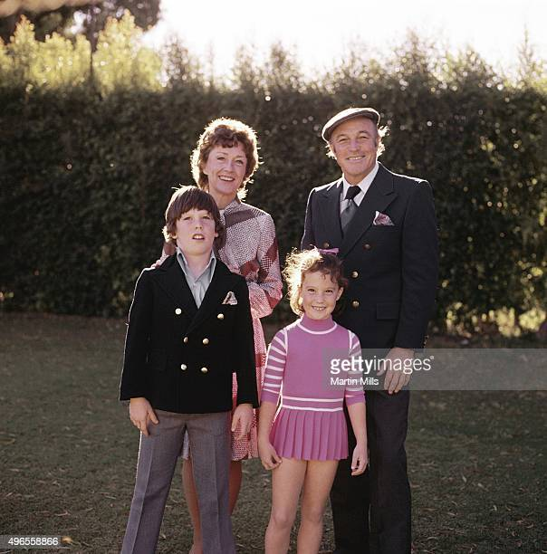 Singer dancer and actor Gene Kelly poses for a portrait with his wife Jeanne Coyne and children Tim and Bridget at home circa 1971 in Beverly Hills...