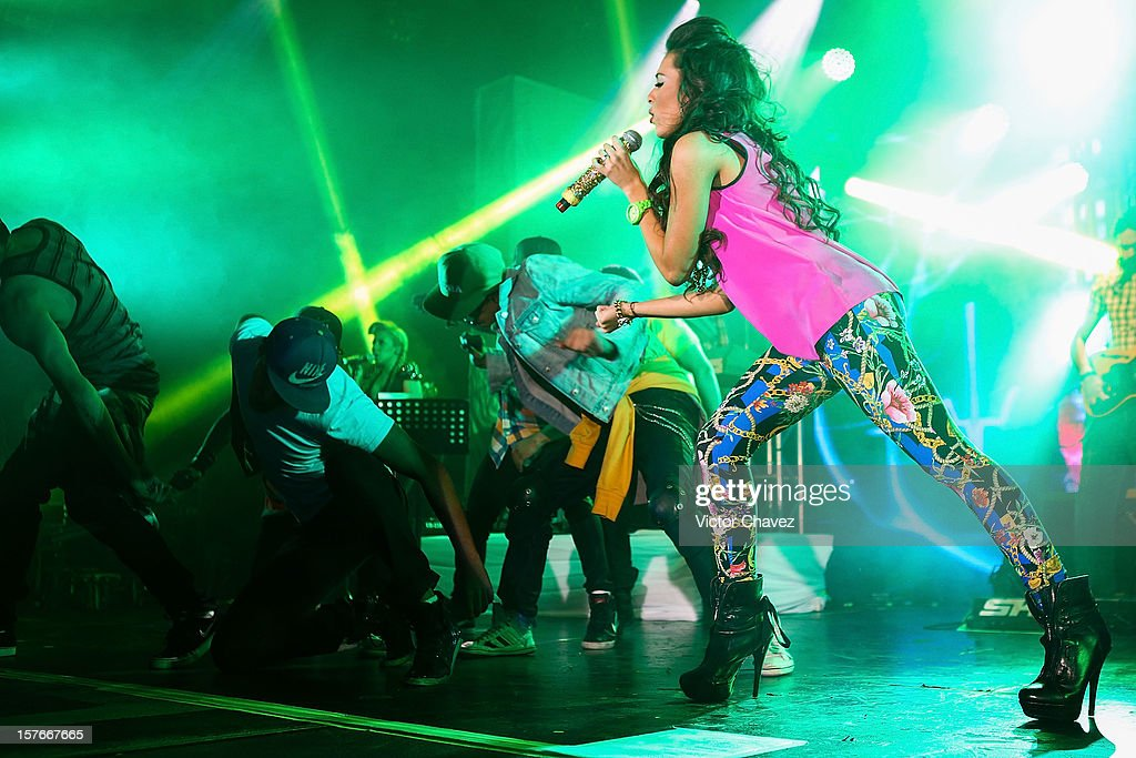 Singer <a gi-track='captionPersonalityLinkClicked' href=/galleries/search?phrase=Danna+Paola&family=editorial&specificpeople=5853275 ng-click='$event.stopPropagation()'>Danna Paola</a> performs onstage at Lunario del Auditorio Nacional on December 4, 2012 in Mexico City, Mexico.