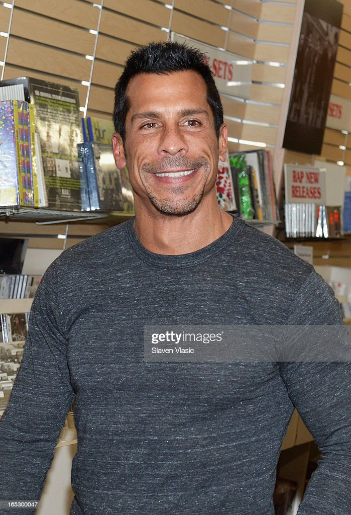 Singer <a gi-track='captionPersonalityLinkClicked' href=/galleries/search?phrase=Danny+Wood&family=editorial&specificpeople=761327 ng-click='$event.stopPropagation()'>Danny Wood</a> of New Kids on the Block attends the New Kids on the Block fan meet and greet at J&R Music World on April 2, 2013 in New York City.