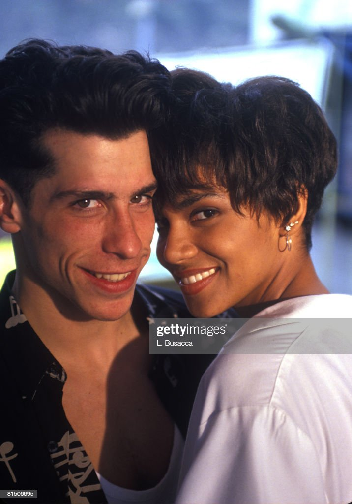 Singer Danny Wood of New Kids On The Block poses with Actress <a gi-track='captionPersonalityLinkClicked' href=/galleries/search?phrase=Halle+Berry&family=editorial&specificpeople=201726 ng-click='$event.stopPropagation()'>Halle Berry</a> backstage during a circa 1989 concert.
