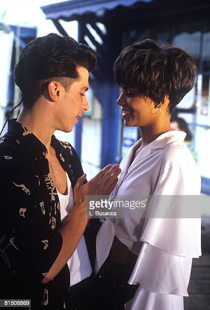 Singer Danny Wood of New Kids On The Block poses with Actress Halle Berry backstage during a circa 1989 concert