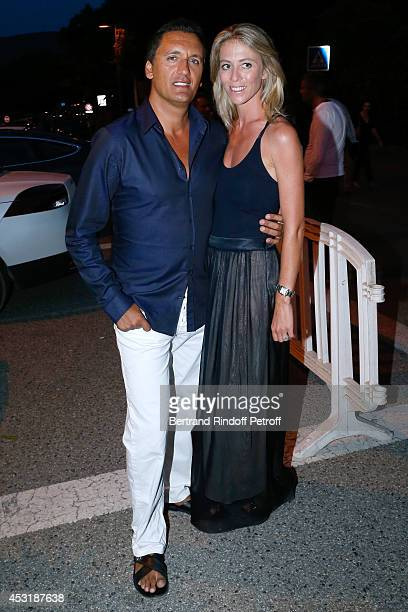Singer Dany Brillant and his wife Nathalie Moury attend the 30th Ramatuelle Festival Day 4 on August 4 2014 in Ramatuelle France