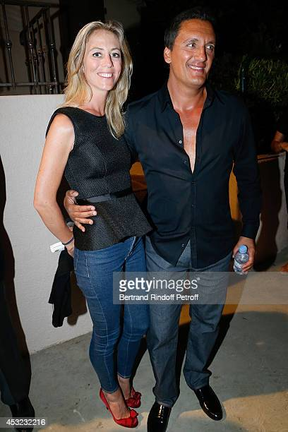 Singer Dany Brillant and his wife Nathalie Moury attend the 30th Ramatuelle Festival Day 5 on August 5 2014 in Ramatuelle France