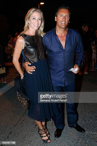 Singer Dany Brillant and his wife Nathalie Moury attend the concert of singer Enrico Macias at the 30th Ramatuelle Festival Day 10 on August 10 2014...