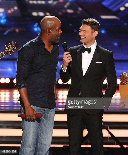 Singer Darius Rucker and host Ryan Seacrest onstage during Fox's 'American Idol' XIII Finale at Nokia Theatre LA Live on May 21 2014 in Los Angeles...