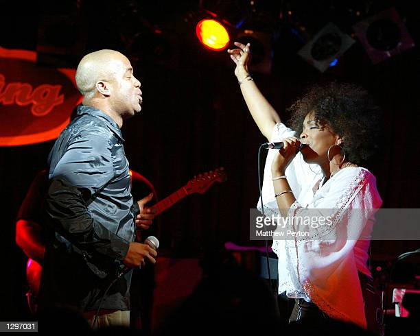 Singer Darius Rucker from the band Hootie The Blowfish and De'Andrea Foster a backup siger perform with his solo band at the BB King's Blues Club And...
