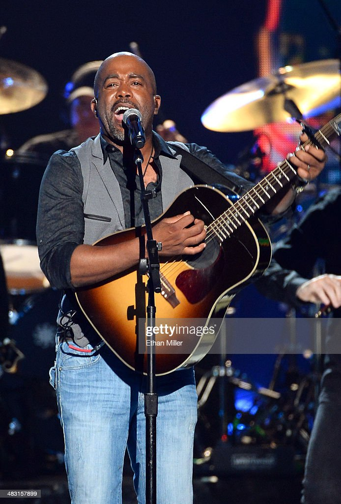 Singer <a gi-track='captionPersonalityLinkClicked' href=/galleries/search?phrase=Darius+Rucker&family=editorial&specificpeople=215161 ng-click='$event.stopPropagation()'>Darius Rucker</a> performs onstage during the 49th Annual Academy of Country Music Awards at the MGM Grand Garden Arena on April 6, 2014 in Las Vegas, Nevada.