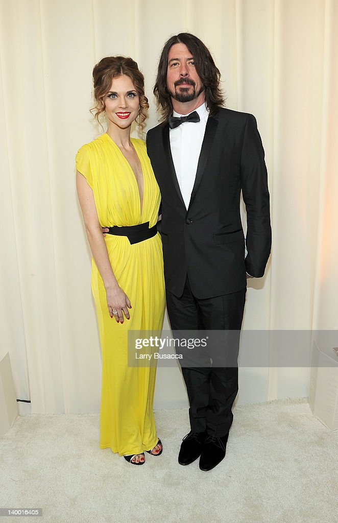 Singer <a gi-track='captionPersonalityLinkClicked' href=/galleries/search?phrase=Dave+Grohl&family=editorial&specificpeople=202539 ng-click='$event.stopPropagation()'>Dave Grohl</a> (R) and Jordyn Blum arrive at the 20th Annual Elton John AIDS Foundation Academy Awards Viewing Party at The City of West Hollywood Park on February 26, 2012 in Beverly Hills, California.