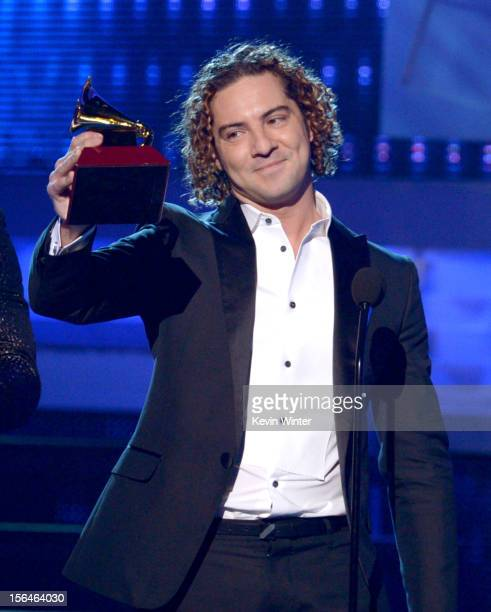 Singer David Bisbal accepts the Best Traditional Pop Album award onstage during the 13th annual Latin GRAMMY Awards held at the Mandalay Bay Events...