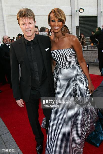 Singer David Bowie and model Iman attend the Metropolitan Opera 20062007 season opening night at Lincoln Center September 25 2006 in New York City