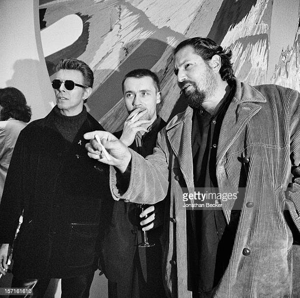 Singer David Bowie artists Damien Hirst and Julian Schnabel are photographed for Vanity Fair Magazine on May 3 1996 at Damien Hirst's opening at...