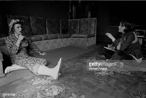 Singer David Bowie being interviewed at his ground floor flat at Haddon Hall where he has been redecorating the ceiling in silver paint Beckenham...